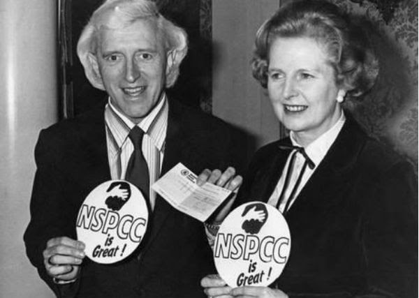Thatcher and Savile donning medals supporting a children's charity. Ironic.