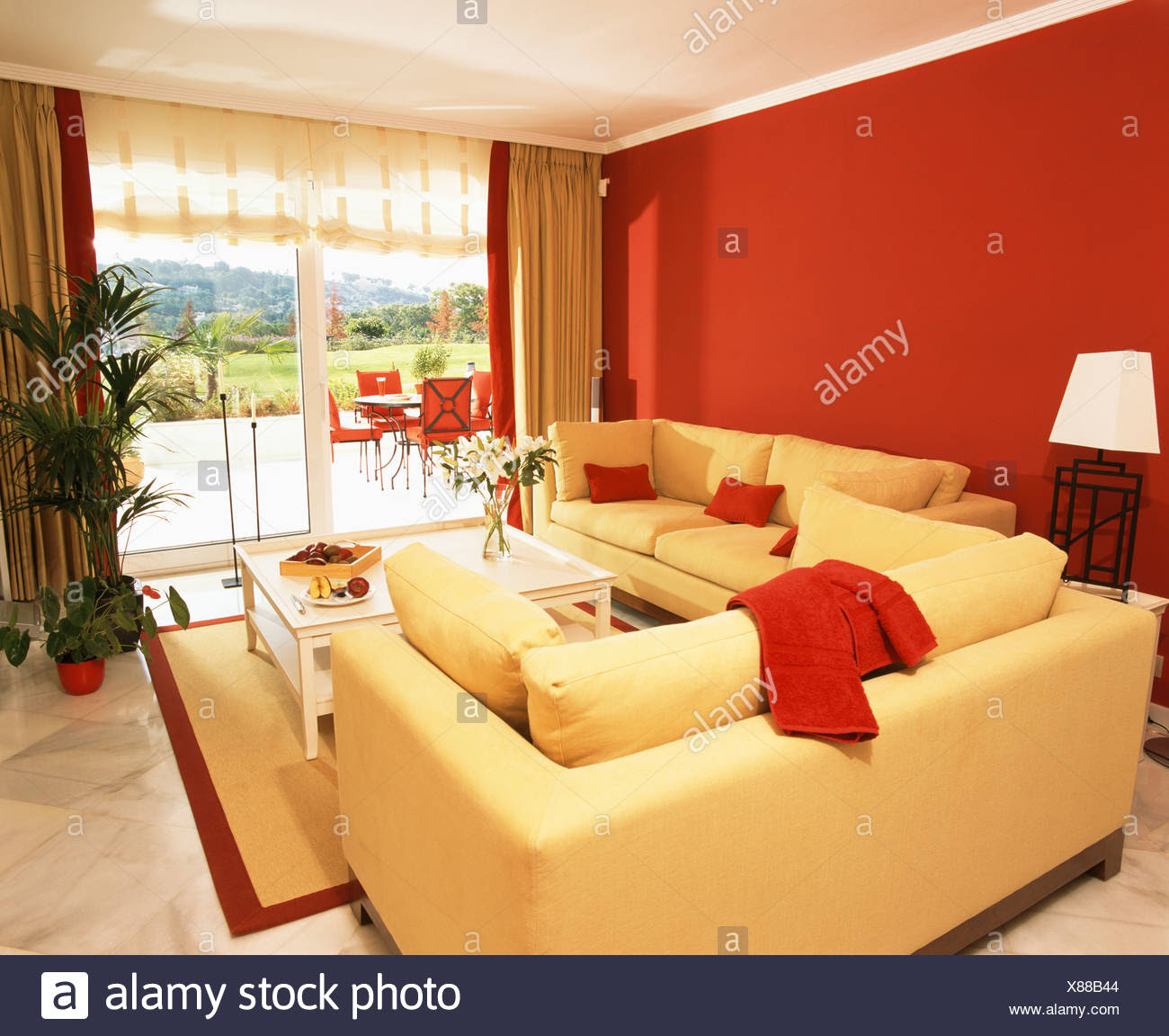 Bright Yellow Sofas And Red Wall In Modern Living Room With French