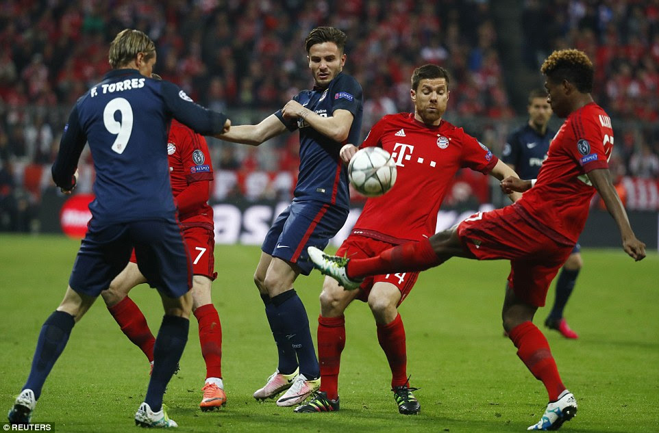 Fernando Torres (left) and Saul Niguez close down Bayern's players as David Alaba looks to clear the ball down the pitch