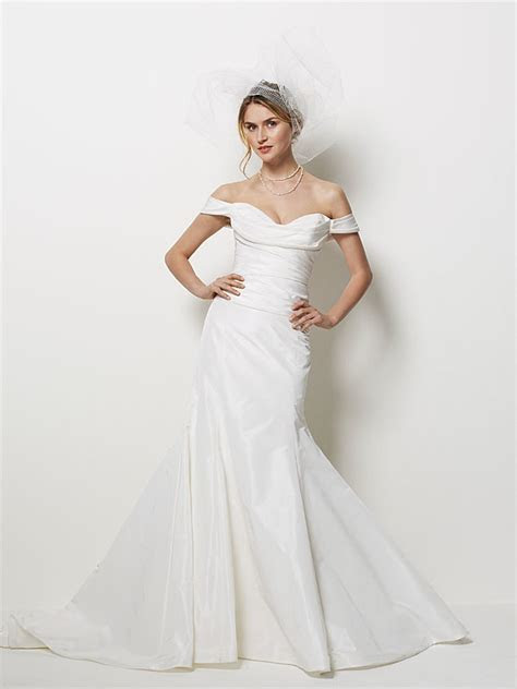 Ivory mermaid wedding dress with off the shoulder cap