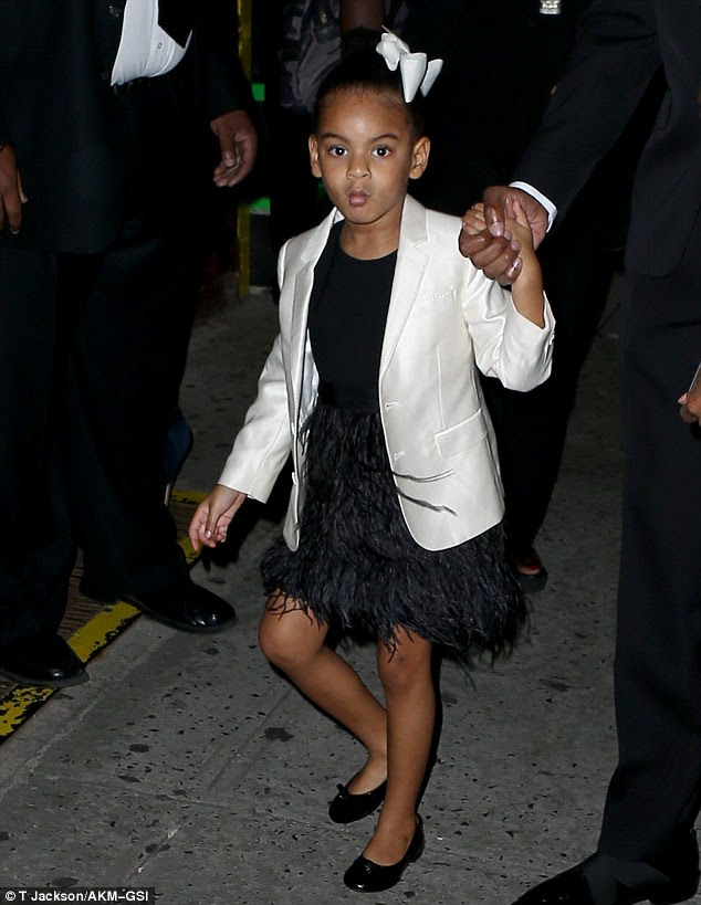 Holding hands: Jay held hands with his daughter as they arrived at the Hammerstein Ballroom
