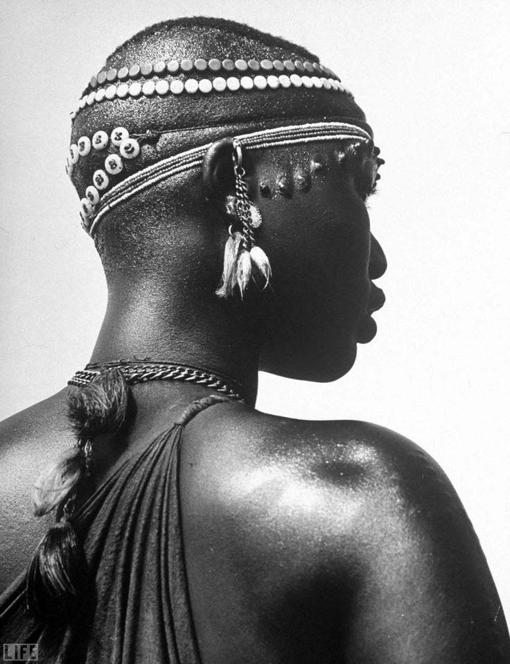 Africa | Shilluk Tribe Girl Wearing Decorative Beaded Head Gear in Sudd Region of the Upper Nile, Sudan | © Eliot Elisofon/Historical archives of LIFE magazine.