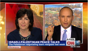 Israel Economy Minister Naftali Bennett showing a 2,000 year old Jewish coin to CNN's Christiane Amanpour, on November 18, 2013. Photo: Screenshot / CNN.