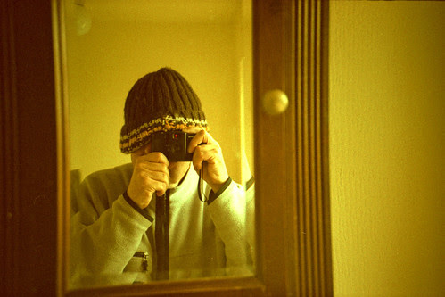reflected self-portrait with Lomo LC-A+ camera and wooly hat by pho-Tony
