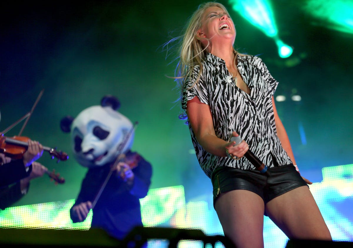 Singer Lesley Roy performed onstage with Deorro and a violin-playing panda.