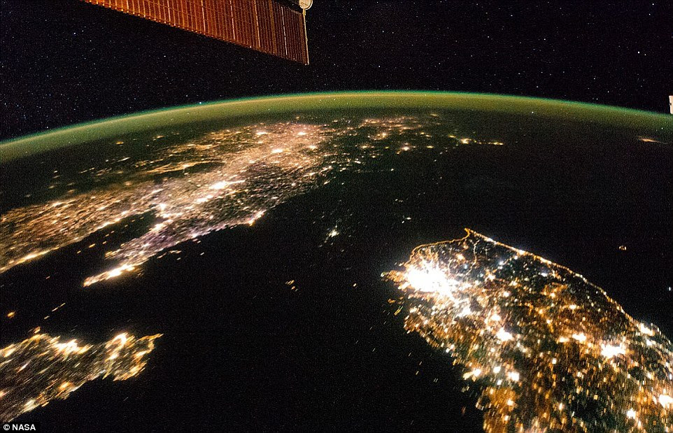 Illuminating: In February, an image taken aboard the International Space Station revealed North Korea as a black hole in a sea of lights.The darkness of the isolated communist state is in stark contrast with the south of the image in which South Korea is shown bathed in light