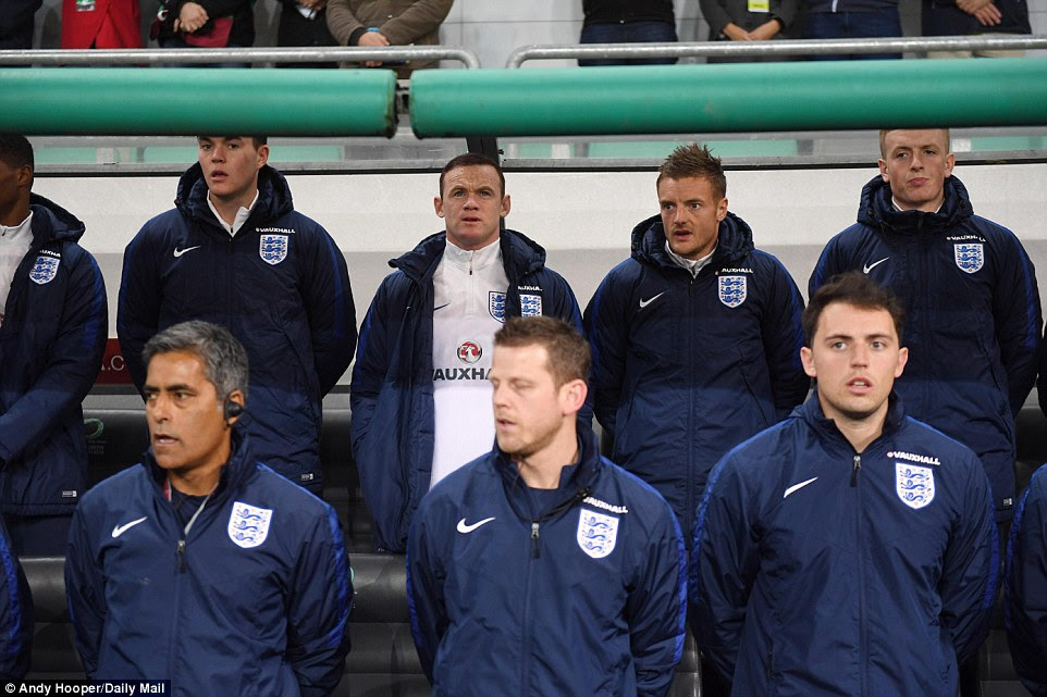 Wayne Rooney (centre) took his place among the substitutes in Ljubljana after being dropped by Gareth Southgate