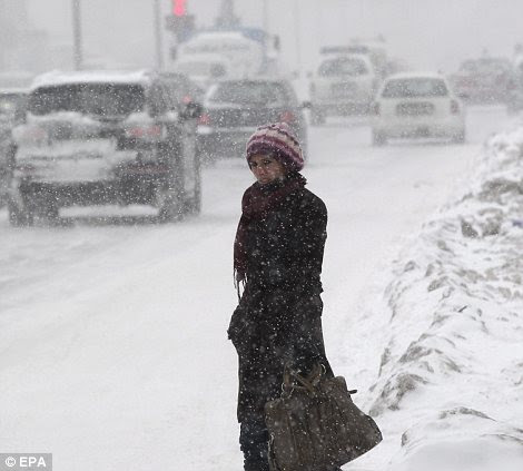 A woman waits for the bus in Kosovo's capital Pristina