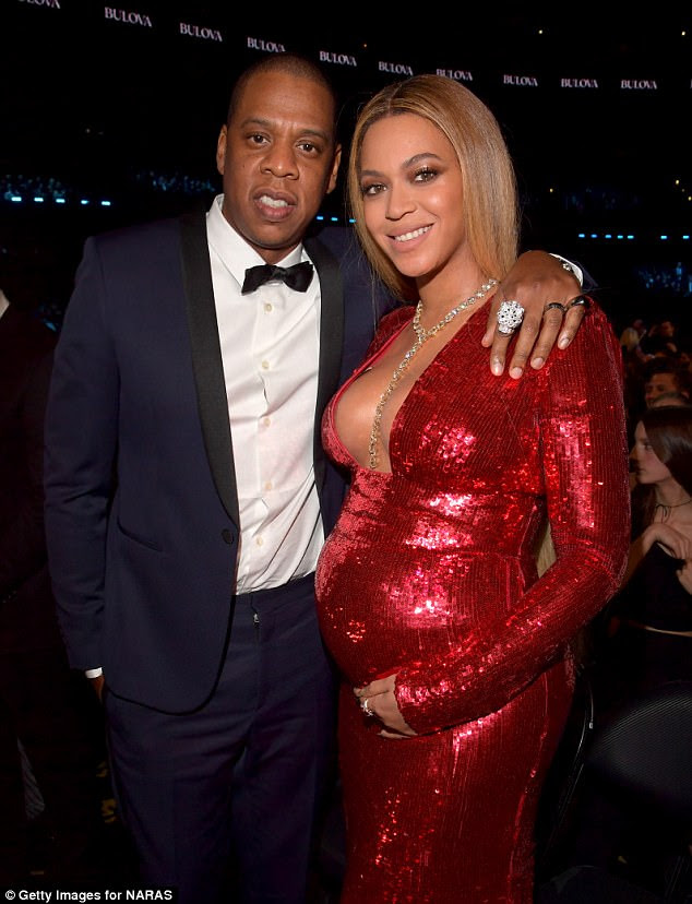 Lots of help: Beyonce and Jay Z have hired six nannies for their new twins, according to US OK! magazine; here they are seen in February