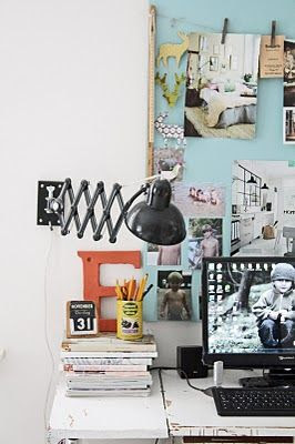 Like this board for pinning things. The colour, the little line and clothes pegs for hanging pictures, postcards etc.