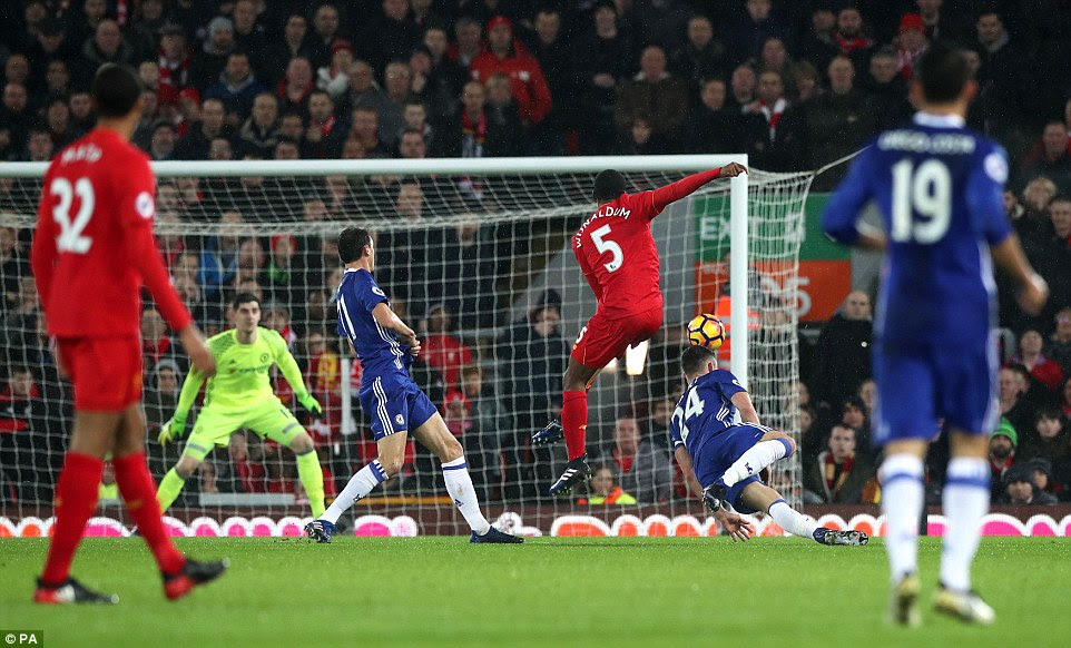 Georginio Wijnaldum shoots from distance on the edge of Chelsea's penalty area as Liverpool search for the opening goal