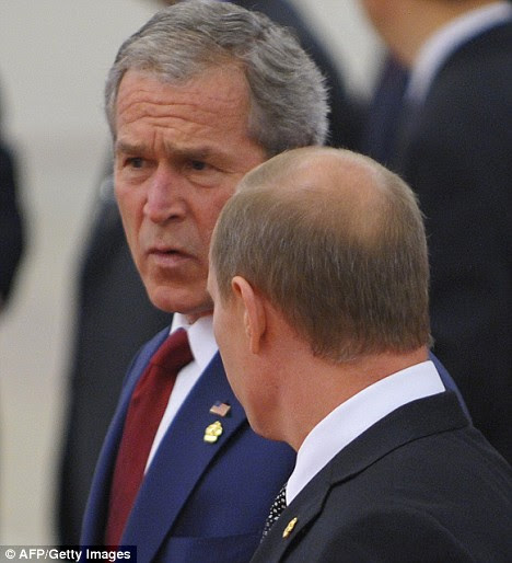 US President George Bush chats with Russian Prime Minister Vladimir Putin