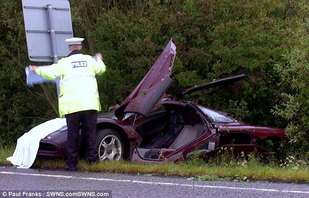 The comedy star lost control of his McLaren F1, careering across the carriageway and into a tree and a road sign before the  sports car burst into flames - it was mended and has now been sold for £8million