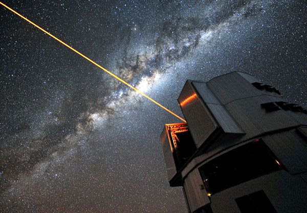 With the Milky Way overhead, a laser shoots out from the Very Large Telescope as part of its adaptive optics system.