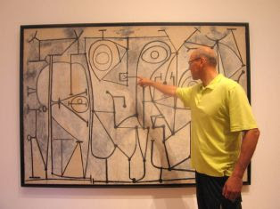 Prof. Jerzy Lewandowski standing by The Kitchen, 1948 by Picasso at the Museum of Modern Art in Manhattan. The lines in the painting are fairly similar to graphs showing the evolution of quantum states of the gravitational field in loop quantum gravity. (Credit: Elżbieta Perlińska-Lewandowska)