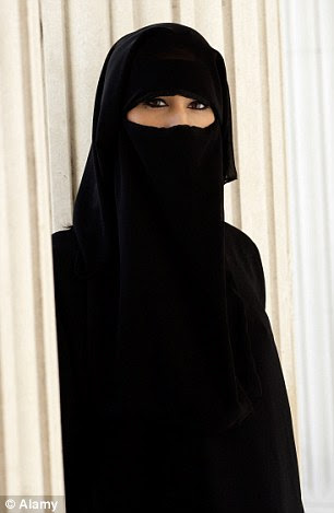 Tension: France is one of the few countries to ban religious veils in schools (posed by model)