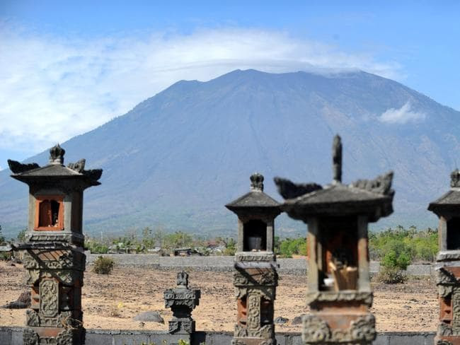 A general view shows Mount Agung behind Balinese Hindu temples seen from Karangasem on the Indonesian resort island of Bali. Picture: AFP