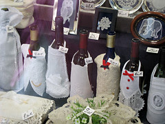 Wine bottles disguised in lace
