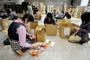 Tokyo citizens sort through relief supplies in Tokyo