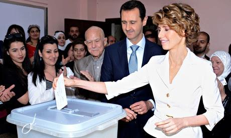 'Disturbing':  Bashar and Asma al-Assad cast their votes in Damascus last week.