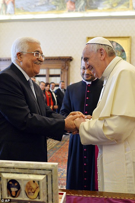 Pope Francis meets Palestinian leader Mahmoud Abbas during an audience at the Vatican yesterday