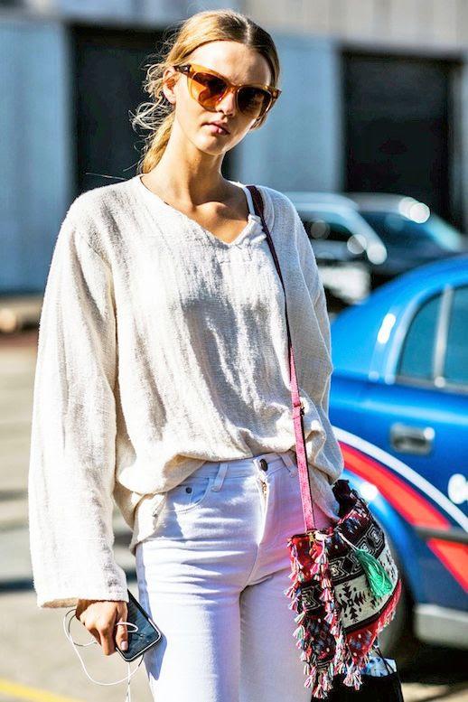 Le Fashion Blog Street Style Candy Colored Sunglasses White Linen Top White Jeans Bright Woven Bag Via Vogue Paris