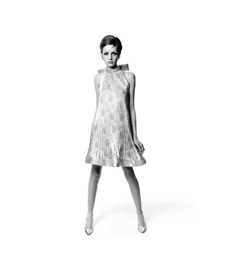 Twiggy in Cardin's pleated dress of silver and green gonfle silk printed in yellow, tinselled with Lurex, earrings by Hattie Carnegie, photo by Bert Stern, 1967