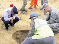 DISCOVERED: Archaeologists and personnel from RAF Lakenheath look at the graves which have been discovered
