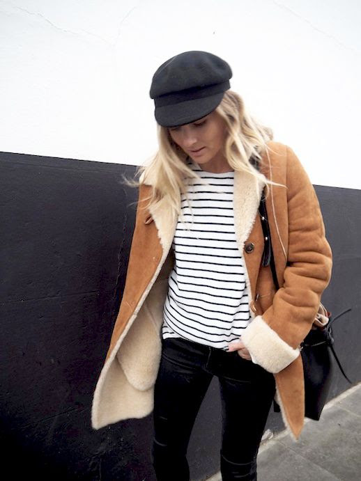 Le Fashion Blog Winter Style Black Cap Shearling Coat Striped Tee Grey Faded Jeans Via Fashion Me Now