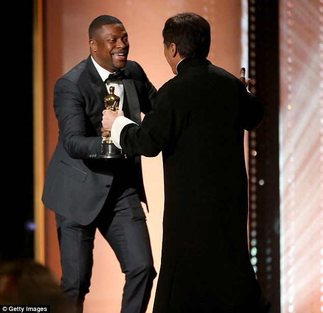 Dynamic duo:Jackie's Rush Hour co-star Chris Tucker was also on stage as he recognised the veteran actor for his contributions to the film industry