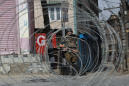 5 dead in Kashmir, shops stage boycott of crackdown by India
