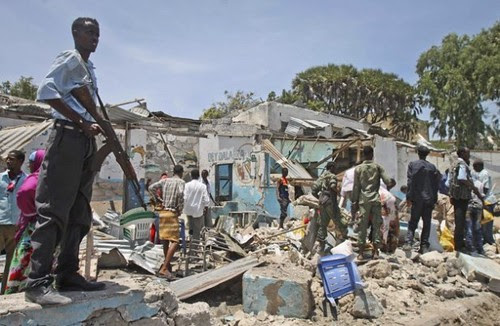 Aftermath of a bomb blast at a tea shop in Mogadishu, Somalia on December 27, 2013. Four soldiers were killed in the attack. by Pan-African News Wire File Photos