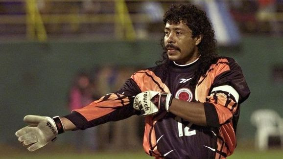 Colombian soccer player Rene Higuita adjusts his s