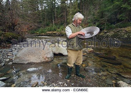 Geologist and gold panner Vincent Thurkettle pans for