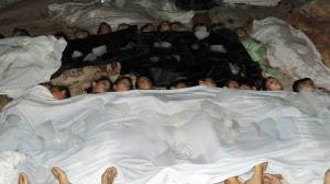 A handout image released by the Syrian opposition's Shaam News Network shows bodies of children laid out on the ground in a makeshift morgue as Syrian rebels claim they were killed in a toxic gas attack by pro-government forces in eastern Ghouta, on the outskirts of Damascus on August 21, 2013. (AFP/Shaam News Network)