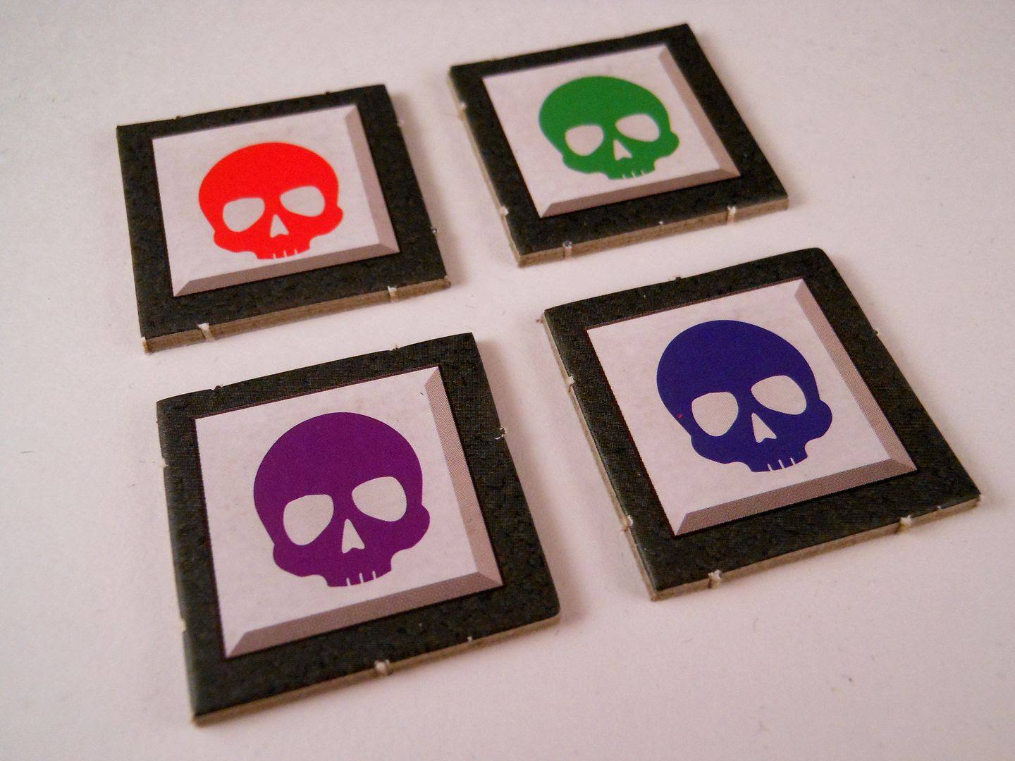 The four colours (yes, apparently there are four colours) of enemy tokens from Gloom of Kilforth.