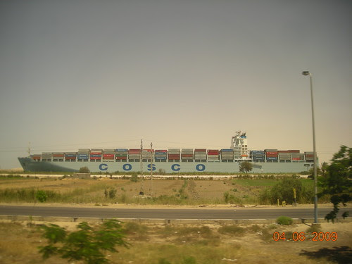 A Ship Is Crossing The Suez Canal. The Picture Was Taken From Ismailiya Highway.