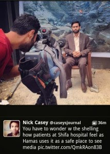 Mushir Al Masri, a Hamas MP and media spokesman, being interviewed by media in front of backdrop showing a destroyed house, and being filmed inside the Al Shifa hospital in Gaza. The photo was posted on Twitter by WSJ correspondent Nick Casey, and has since been removed. Photo: Screenshot.