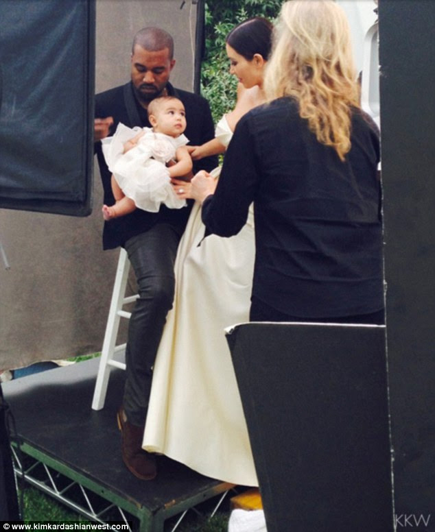 Hi mom: North - who was 10-months-old at the time - wore a pretty white dress with ribbon rose