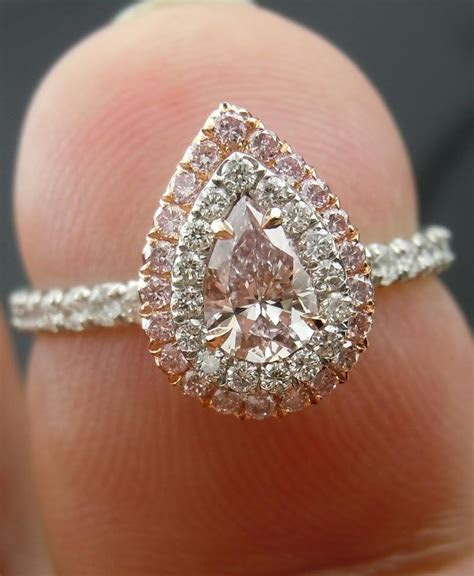 Light pink diamond pear shaped engagement ring with double