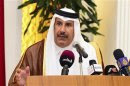 Qatar's PM Sheik Hamad speaks during a news conference in Doha