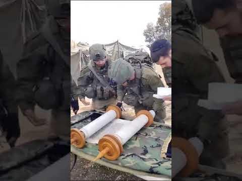 Israeli Soldiers read in the Torah