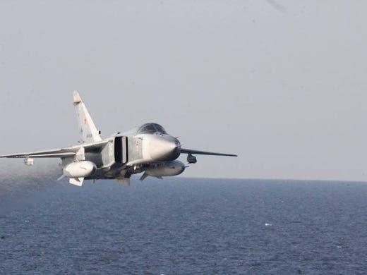 A Russian Sukhoi Su-24 attack aircraft makes a low