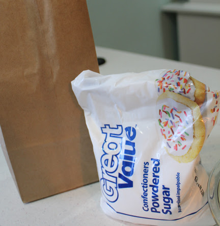 While the Zeppole cool enough to be handled, scoop some powdered sugar into a lunch bag. Drop in a piece of the fried dough and give it a good shake then be prepared to fight people off.