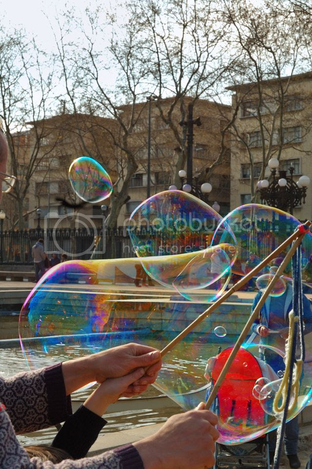 Man and child making soap bubbles in Barcelona [enlarge]