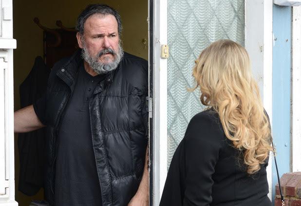 Gordon opens the door to Sharon