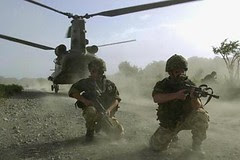 Dutch Marine's of 45 Commando disembark from a Chinook aircraft on Thursday, 27 June 2002, near Khost in southeastern Afghanistan