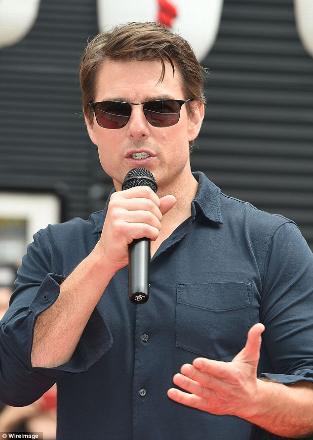 Image result for Tom Cruise with microphone
