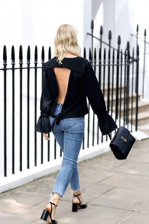 Le Fashion Blog Open Back Black Blouse Black Bag Raw Hem Denim Black Heels Via We The People Style