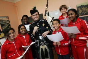 Piper Callum Armstrong with year 6 pupils Kamam Oddy, Andrea Asare, Madaleine Honeyman, Sana Patel, Ashvinie Aravindran